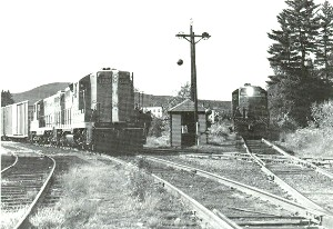 Black and White photos of two trains at switch
