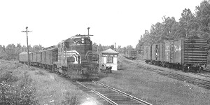 Black and White Photo of two Trains at junction