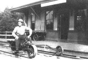 Black and White Photo of man sitting on old motorcycle