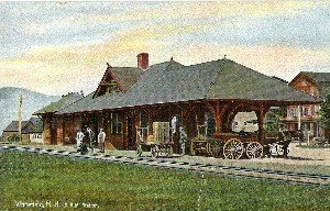 Early Train Station with horse drawn carriages