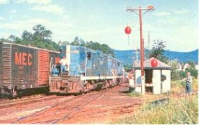 Train Crossing with Blue Train Coming Through
