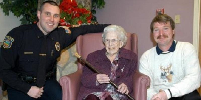Police Officer Kneeling next To Elderly Woman and Care Taker
